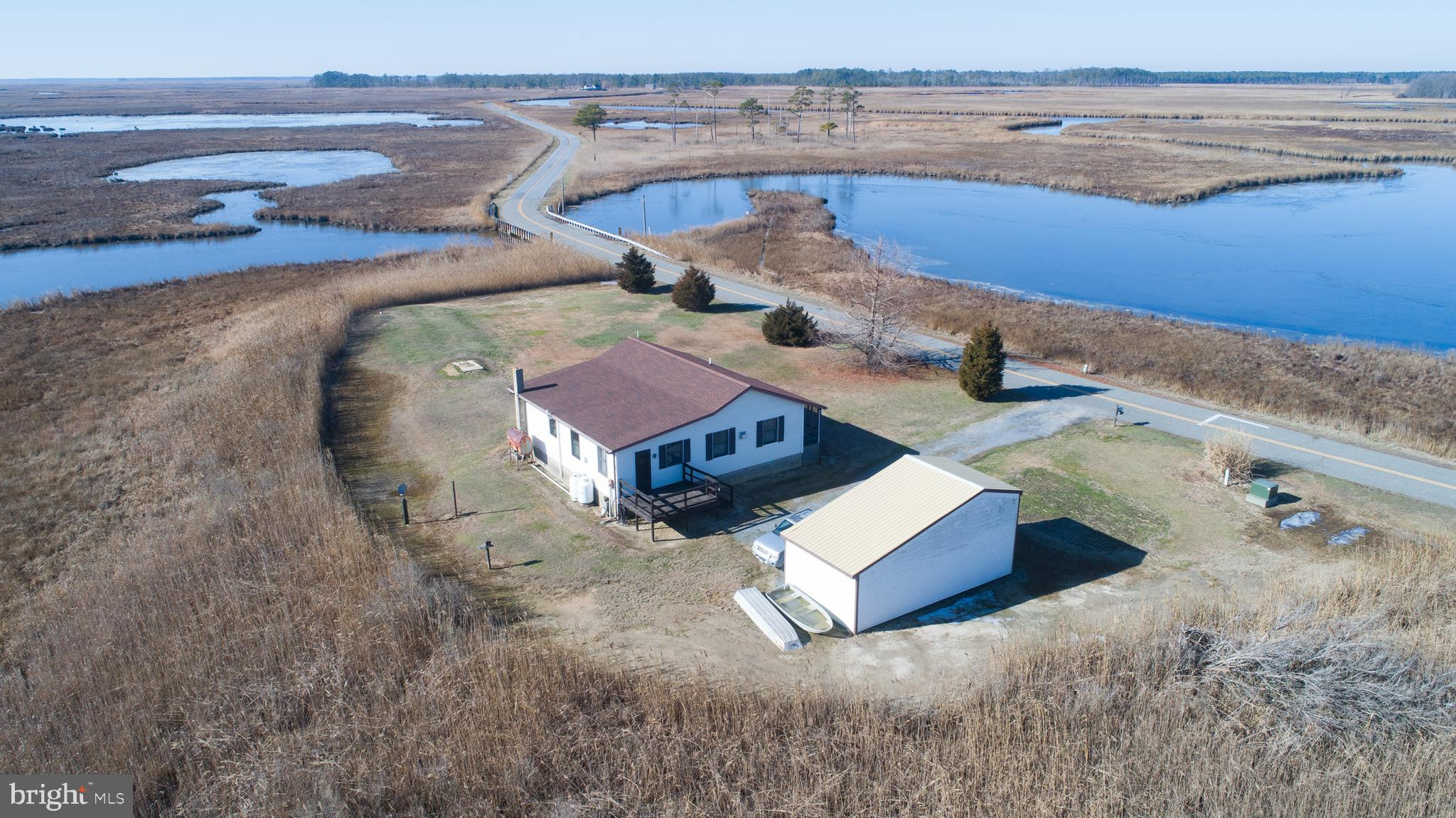 Looking for a private waterfront spot to call your own?  This is it!  3 +/- acres with tranquil views across marsh and the Transquaking River.  Enjoy your own private dock for fishing, crabbing or just watching the tide move! Cute 2 BR cottage in excellent condition. Large rooms  and 1 1/2 baths.  Screened front porch and side deck. Also includes a large shop/outbuilding for all your hobbies. Established garden planted for this year - buy now and enjoy fresh vegetables all summer! Recently surveyed.The bridge at Bestpitch is closed. Go through  Vienna -