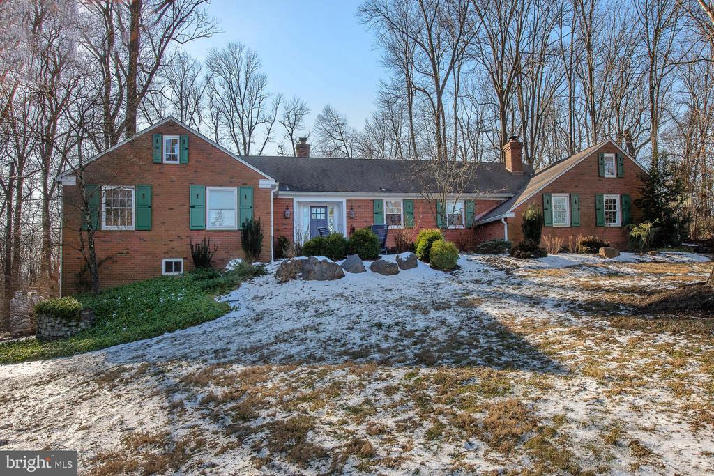 Gracious one-floor living, solidly built all-brick construction, well appointed with high quality and tasteful finishes, and situated on a lovely private and serene 1.3 acre level lot with matured landscaping and remarkable hardscaping, are just a few hallmarks that define this desirable home. Generously proportioned rooms throughout, high-end chef's Kitchen, dramatic step-down Family Room with radiant heat, wide-plank wooden floors, floor-to-ceiling stone fireplace and handsome coffered ceiling. Formal Dining Room with French doors to on grade stone terrace offer grand scale entertaining options, formal fireside Living Room, comfortable screened-in porch for rainy days all work together to create unparalleled living. Four nicely sized Bedrooms, including Master Suite with wall of windows overlooking stunning grounds. Updates abound with refinished hardwood floors, basement carpeting, new master bathroom, security system, custom exterior shutters, auxiliary generator, walkways, patios, new light fixtures throughout and freshly painted interior/exterior!  Expansive finished walk-out lower level with windows, built-in office center, entertainment unit, and Full Bath offer endless possibilities to serve any number of purposes including a Fifth Bedroom alternative. Fabulous floor plan is desirable and stacks up better than many traditional two-story colonials. Square Footage includes finished lower level of 1273 square feet. Convenient location with close proximity to public transportation, major roadways. Sought after neighborhood. Enjoy the benefits of award-winning T/E Schools including cherished Beaumont Elementary. Hurry for your chance to purchase an elegant and sophisticated home! This is Easttown Township living at its finest!
