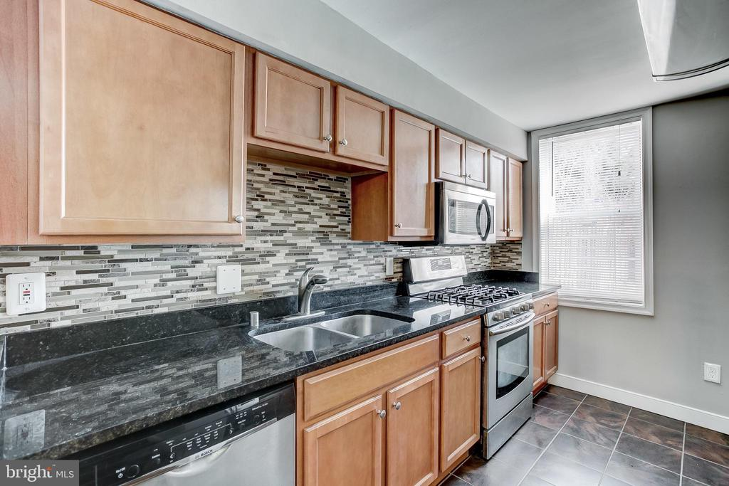 Perfectly situated & affordable renovation close to the market! Check out this 1200sqft+, 2 bedroom / 1 full bath / 3 level home featuring a beautifully updated kitchen with premium finishes and stainless steel appliances. Enjoy the open floor plan that opens to the family room & dining room with custom finished hardwood floors. Upper floor has great Over-sized Bathroom & Master bedroom. This home has a perfect & private fenced in backyard great for entertaining with friends. Fantastic large basement perfect for storage. Located in the heart of Hollins Market and a short walk to a handful of hot-spots in the southwest.