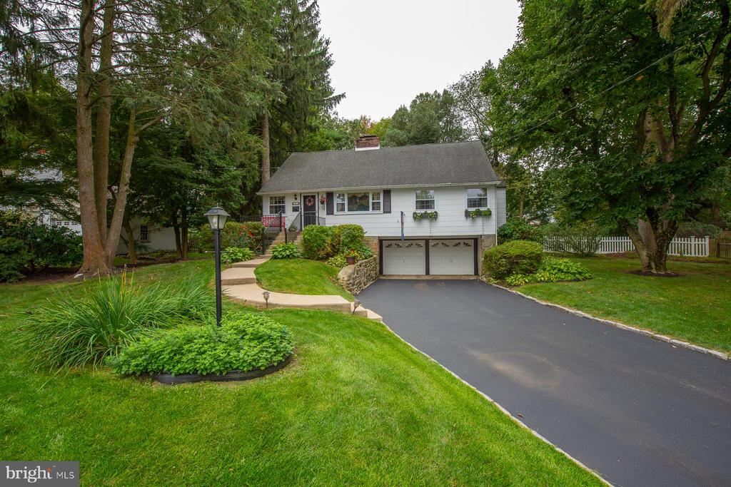 A wonderful place to call home! This lovingly maintained 4 BR, 2 full bath Cape is nestled on one of the prettiest streets in a highly sought-after North Wayne neighborhood. It's within walking distance to the Wayne Train Station in award-winning Radnor Schools! Set on a large flat .43 acre lot with mature plantings, this solid cape has everything you need with plenty of space to grow and make it your forever home. Offering a traditional floor plan with spacious rooms and 8 ft ceilings on the first floor, there are hardwood floors through out the house.  The updated kitchen, and sunny Breakfast room off the back seamlessly flows into the Family room with gas fireplace.  The large Living Room features hardwood floors, a wood burning  fireplace with traditional wood mantel.  The formal Dining Room with chair rail and hardwood floors leads to the updated Kitchen .  The family room has a gas fireplace, vaulted ceiling, and sliding door to the large deck and fenced backyard.  The first floor has the main bedroom, a second bedroom (used as an office), a linen closet and full ceramic tile Bath with tub/shower.  The second floor features a reading loft with window seat, large Bedroom with hardwood floors and a walk-in closet, the third Bedroom with hardwood floors and closet, and a full hall Bath. The lower level offers tons of potential with an outside entrance, fireplace, and built-ins.  The laundry area has washer, dryer, and plenty of storage. The 2 car garage space has extra storage. Located in the heart of a vibrant Wayne neighborhood, convenient yet off the beaten path. Walking distance to the Wayne Train Station and convenient access to the Downtown.