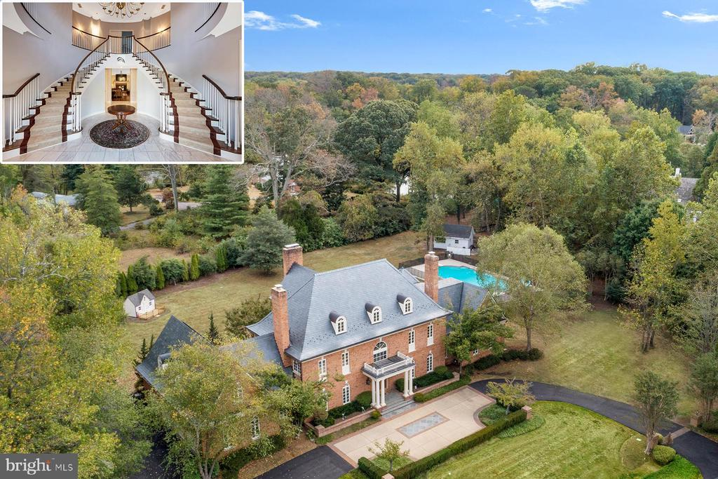 3057 Rundelac Road is a five-bedroom, all brick waterfront estate home located on Aberdeen Creek. The home is situated on two beautiful acres boasting a park-like landscaped yard surrounded by mature trees, an in-ground pool, and a private pier with deep water. Enjoy quick access to downtown Annapolis, shopping and dining, and major commute routes.  The circular drive, featuring decorative brick and stonework, welcomes you with style.  As you step into the grand two-story foyer, your eyes are drawn upward by the majestic double staircase. The ceiling is accented by the multi-tiered candlelight chandelier and ornate medallion. The formal living room on one side has beautiful hardwood floors, a wood-burning fireplace with black-marble surround, chair rail accent, crown molding, and tons of natural light. The formal dining room, with beautiful chandelier, offers a pellet stove to warm your gatherings. Through the foyer, the family room features an oversized wood-burning brick-surround fireplace; a breathtaking focal point of this space. There~s also updated lighting, hardwood floors, a wet bar and French doors leading to the waterside patio. The family room flows nicely into the gourmet kitchen with informal dining space and oversized center island with breakfast bar. Top-of-the-line finishes include updated white cabinetry, black quartz countertops, Jenn-air double wall ovens, a Subzero refrigerator, and a separate beverage fridge. Down the hall the two-story solarium has a soaring ceiling, fantastic natural light, and plantation shutters.  The main level also includes a home office that could be used as a sixth bedroom, two full bathrooms, and a laundry room. Upstairs, the master suite, with gorgeous gas-fireplace, is located off the grand second floor landing. This oasis setting has a luxurious private bathroom with two vanities, jetted tub, separate tiled shower, and ample storage. Glass doors in both the bath and the bedroom lead to a private waterside balcony ove