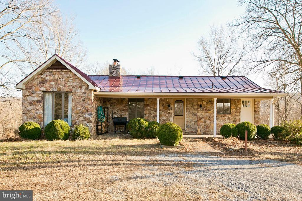 Beautiful stone Ranch-style home on 101.24 acres with direct riverfront on the Shenandoah. Recently updated throughout, the home features a newer metal roof, an open floor plan and fully finished walk-out basement with full bath and spacious Family Room and Game Room. The gourmet kitchen is open to the Great Room and includes stainless appliances, a six-burner gas stove, granite counters and an island. The barn has been converted into a 2 bedroom apartment and workshop.