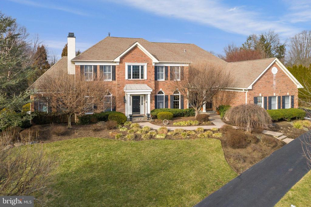 Meticulously and beautifully updated 5 Bedroom, 5.2 Bath brick front Colonial home approaching the quiet cul de sac. Gorgeous in-ground saltwater pool with spa in a lush private setting. Enjoy the exceptionally renovated custom gourmet Kitchen with white cabinetry, center island with double thickness quartzite counter, Thermador built-in refrigeration, Wolf cooktop and double ovens. Step out to the welcoming screened porch with flagstone floor, skylights, ceiling beams and access to low maintenance decks on either side. Back inside, the spacious and impressive Family Room offers a gas fireplace and custom built-in cabinetry. The elegant Dining Room with lovely millwork boasts matching cabinetry which serves as a Butler's Pantry.  A private 1st Floor Office with a wall of built-ins is super convenient. The second fireplace, wood burning,  is discovered in the serene Living Room. Don't miss the 1st Floor Suite which is so versatile and flexible. This 2-room suite with a full bathroom is ideal for an in-law, nanny, a home gym or pool cabana with access to the rear yard and pool.  Main Floor Laundry and a Powder Room complete this living level. Upstairs, every light filled Bedroom offers an updated full Bathroom plus large custom fitted closets. The Master Suite is a true retreat with a tray ceiling, inviting Sitting Room, generous  walk in closet and sumptuous custom renovated Bath with double vanity and a separate make up vanity with sink, an over-sized shower, free standing tub and separate water closet. The finished Lower Level will delight those of all ages with great recreation space, a built-in bar with beverage refrigerator, sink and cabinetry, a separate wine room with special shelving, Powder Room and plenty of storage in the unfinished space. Attached 3-car garage provides a full wall of custom cabinetry for organized storage. Ideally located with super access to the R5 train line, Philadelphia Int'l Airport, major arteries, Episcopal Academy, the new Whole Foods, numerous country clubs, recreational outlets and wonderful shopping and dining destinations. Enjoy living in the top rated Tredyffrin-Easttown school district. This outstanding property will delight the most discerning Buyer. Click the video link above for a tour of this very special property.