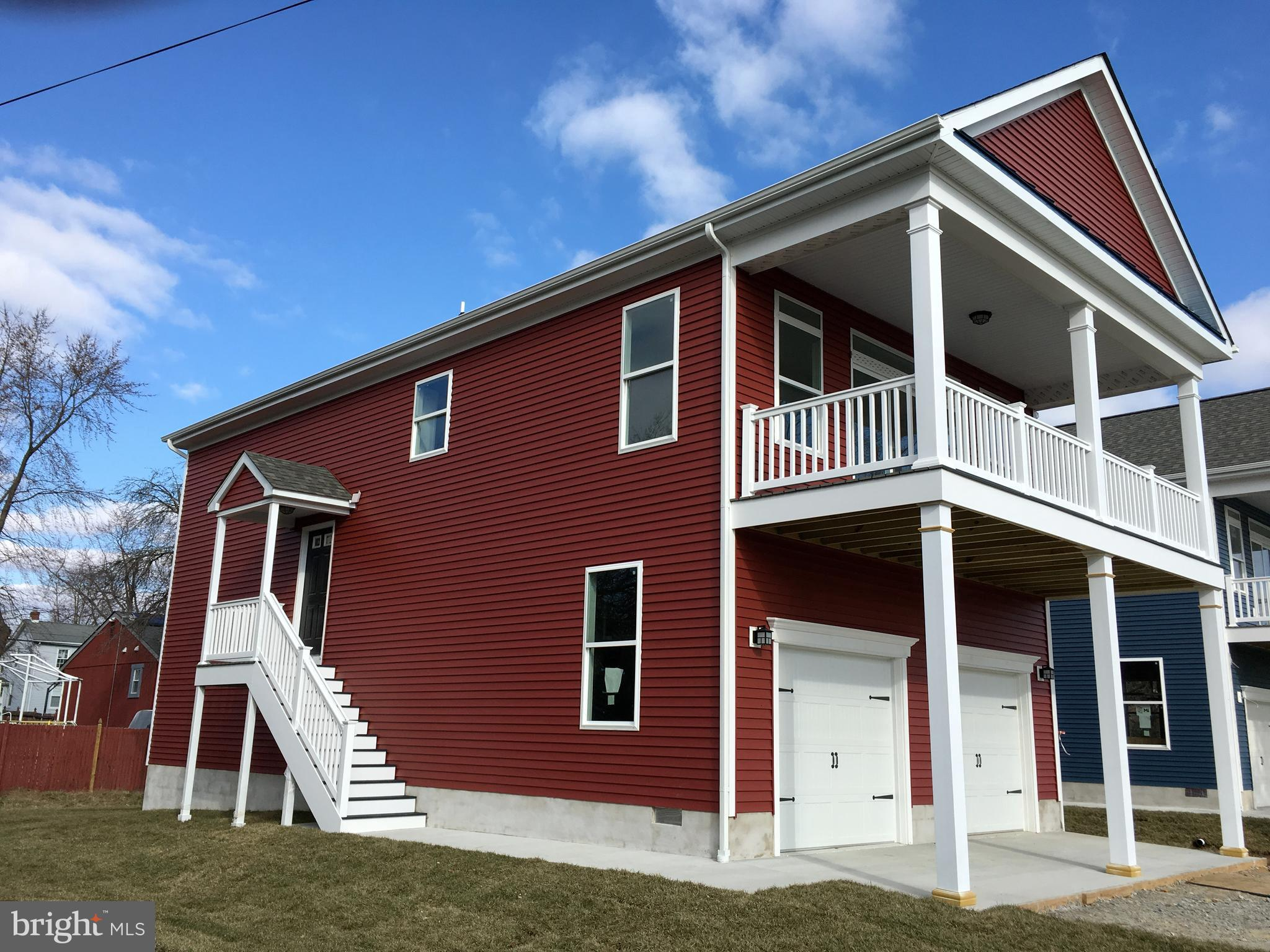 """Quick Delivery - New Construction with water view of the Branch Canal, Public Marina and Fort DuPont. Beautifully designed Cottage Style Home with single floor living on upper level including  covered porch for outdoor living area. 3 bedroom, 2 1/2 bath with Great Room / Kitchen / Dining combination with 9' ceiling height & trey ceiling. Oversized two car garage includes storage closets. Home is nearing completion with quick delivery possibilities. Upgraded features include; 42"""" white cabinets & vanities, granite counter tops, oak stairs & railings, LVP Flooring, Ceramic tile floor and shower in owners bedroom, composite decking, vinyl porch post & railings and much more. Community includes the Delaware River, Branch Canal, Restaurants, Public Marina, Historic Main Street District, Hiking trails,  Battery Park and Fort DuPont all within walking distance of your front door."""