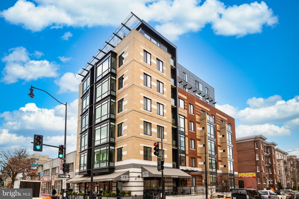 OFFERS, IF ANY, DUE TUESDAY FEB 4TH AT 3PM. Live in the heart of Logan Circle in this beautifully renovated and modern corner unit on 14th Street, one of the most desirable streets in Washington. This 2BR 2BA + GARAGE PARKING, offers an open floor plan, northern and eastern exposures, floor-to-ceiling windows and 8.5' ceilings, which provide tremendous natural light throughout. The spacious living and dining area opens to the contemporary kitchen with stainless steel appliances, marble backsplash and island/breakfast bar with upgraded pendant lighting, and under counter and over-cabinet LED lighting. Numerous upgrades include: wood floors throughout, high-end motorized privacy shades on all windows, dimming lighting throughout, upgraded electrical system and lighting, and Nest thermostat and smoke alarm/carbon monoxide detectors. The spacious and light filled master bedroom connects to the en-suite master bathroom. The second bedroom is very spacious and there is a full hall guest bathroom with bathtub. There is ample closet space throughout, and a convenient in-unit Washer and Dryer. The Juliet balcony provides a unique nook to step outside. A separately deeded garage parking space completes this outstanding condominium. The Aston (built in 2013) is a pet-friendly boutique building with bike storage.  Ideally located in the heart of Logan, between Shaw and Dupont Circle, and is easily accessible to Downtown and U Street. The Aston offers close proximity to Whole Foods, Trader Joe's, and an Amazon Go store coming soon across the street. It is next to multiple coffee shops, fitness studios, some of the best restaurants, and shopping: Le Diplomat, Barcelona, Ghibellina, Pearl Dive, Sette, Bluestone Lane (new), Shinola, Sephora, SoulCycle, Milk Bar, Jrink, Miss Pixie's, Cork, Bodysmith Gym, Vida Fitness, Flow Yoga. There are three Metro stations within a mile from the property, as well as multiple bus lines on 14th. The 14th Street Streetscape project is expected to co