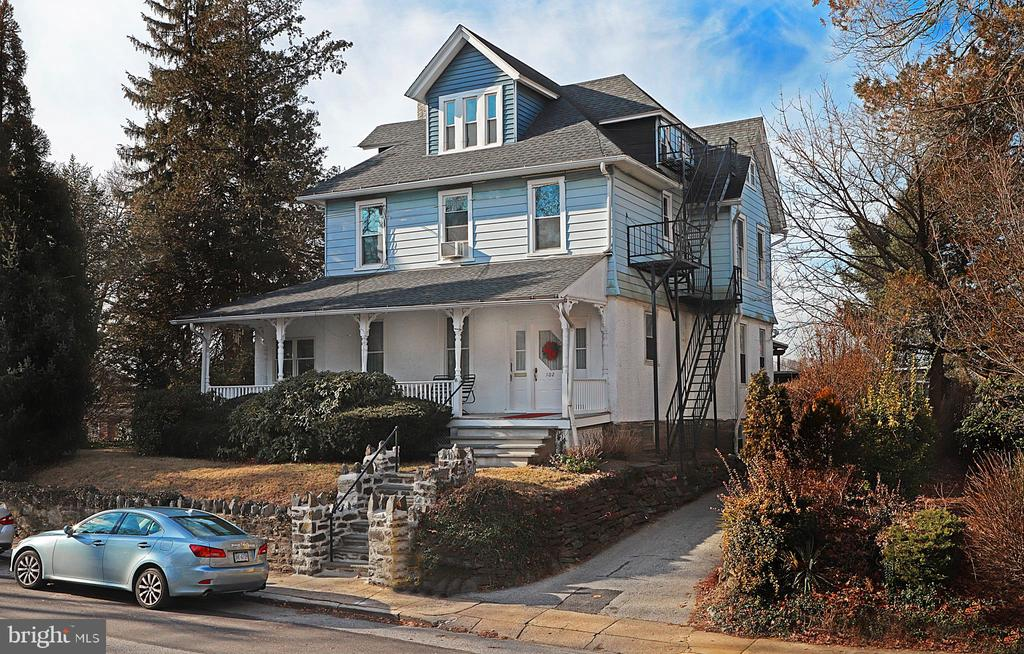 Here's a charming Victorian in convenient Narberth that is currently a 4-unit residence. The owner-occupants have moved from the spacious 1st floor unit that is now vacant. The two 2nd floor units and the 3rd floor unit are currently rented. The 1st floor unit has 1 bedroom and an office that could become a 2nd bedroom. This unit has a large kitchen with its own clothes washer/dryer combo unit. There is access to the large Trex deck and chair lift from the 1st floor kitchen.  The 1st floor unit contains 5 rooms and a bath (+/-1373 square feet). The 2nd floor front unit has 1 bedroom, kitchen, living room and bath  (+/- 488 square feet at $850).  The 2nd floor rear unit has 2 bedrooms, living room, kitchen, bath ( +/- 725 square feet at $950 monthly). The 3rd floor unit has 1 bedroom, bath, kitchen with eating area, and living room (+/- 631 square feet at $975 monthly). All units have separate gas and electric service and the tenants pay their own utilities. Three of the units have gas-fired radiator heat. The 2nd floor front unit has electric baseboard heat. Their is a common coin-op laundry in the basement.  The basement also has 2 large finished rooms and a full bath offering great potential to expand the living space of the 1st floor unit. The private yard is fenced. This property has been well-maintained by the current owner-occupants. Also listed as Multi-Family MLS# PAMC637242.