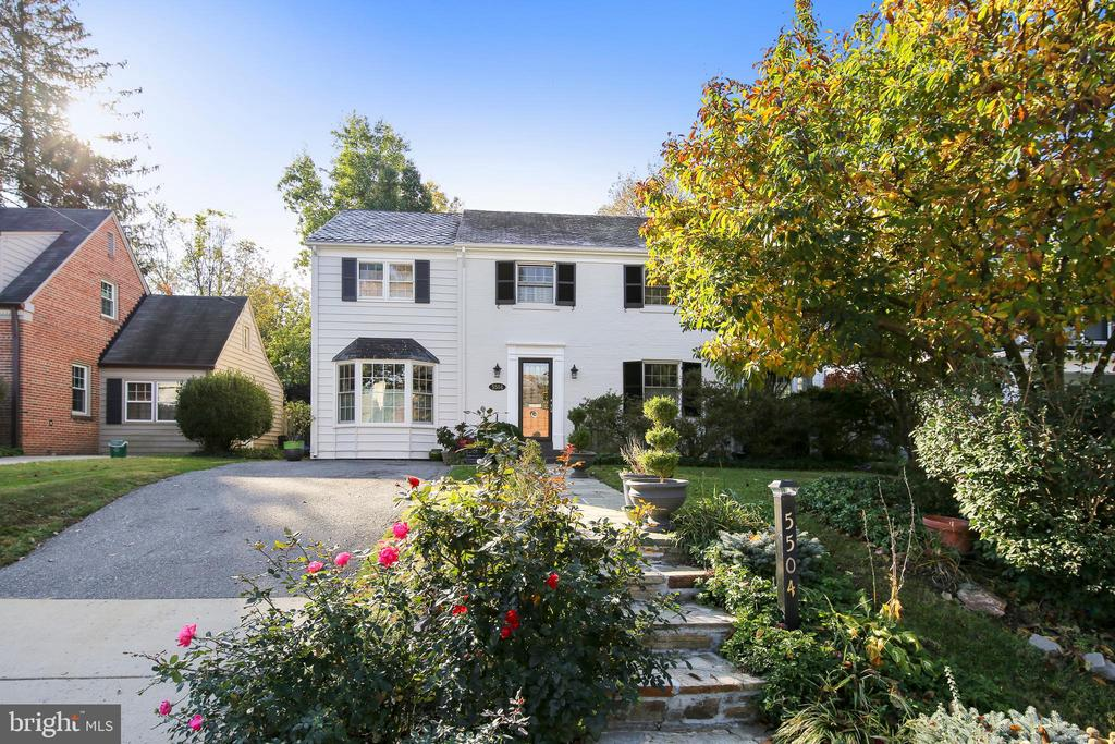 Nestled in a beautiful neighborhood near Suburban Hospital and downtown Bethesda, in the Whitman school district, this enchanting colonial has an urban contemporary feel. Enjoy a freshly painted interior and exterior, and new carpets in the bedrooms. Spend evenings in front of a wood-burning, white brick fireplace in the living room or the adjoining sun room with attached patio, and entertain in the formal dining room. A 13'x35' addition includes a family room with bay window, and casual dining area leading to a completely private deck with hot tub. The cherry wood kitchen has granite counters, stainless steel appliances, wine storage, and a pass-through into the family room. A breakfast room provides a dreamy nook, with conservatory windows, white brick walls, a free-standing gas stove, and a large island with pendant lighting. The adjacent office contains a powder room and access to a screened-in porch. Ceiling fans and recessed lighting add comfort and ambience to each room.Upstairs are 4 bedrooms with ceiling fans and 2 full baths. A heat pump supplies cool/warm air separately from the rest of the house and the owner's suite bathroom offers a button for hot water recirculation. The finished lower level has a carpeted rec room, full bath, laundry area, second fridge, and storage space. Don't miss the opportunity to own this gem!