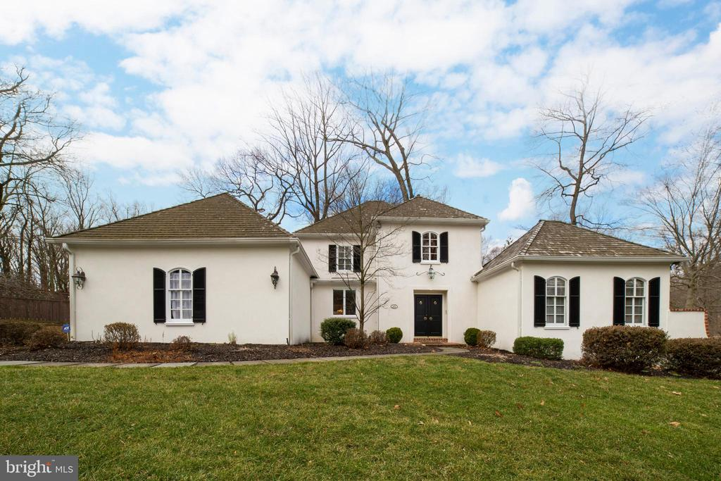 Welcome to 121 Woods Lane! This exquisite property sits on a premier lot with lush landscaping and a pool in the coveted neighborhood of The Woods. The double front doors lead to a two-story foyer with sweeping staircase and views of the elegant living room and rear property.  The eat-in kitchen features white cabinetry, new stainless steel appliances and is highlighted by a sunlit breakfast room with skylight.  Adjacent to the kitchen is the formal dining room offering easy access for entertaining.  The spacious living room is highlighted by a marble surround gas fireplace with a carved, wood mantle and large picture window which overlooks the beautiful grounds.  Beyond the living room is the family/great room which boasts a floor to ceiling brick wood burning fireplace, dramatic vaulted beam ceiling, and built-in custom wet bar with French doors to private deck.  The first floor bright and spacious, master suite is complete with tray ceiling, two closets, one walk-in, and updated master bath with granite vanity and large shower with skylight.On the second level you will find three generous sized bedrooms and a full bath.  The finished, bright, walk-out lower level features a large recreation room, kitchenette and a half bath with access to the pool area, ideal for summer entertaining.  ~Enjoy all that The Woods has to offer such as annual block parties, progressive dinners and two cul-de-sacs for kids to safely ride their bikes.This premier location provides convenient access to the village of Wayne, with its upscale shops and restaurants, Wayne and Radnor train stations and major roadways. Award winning Radnor schools!