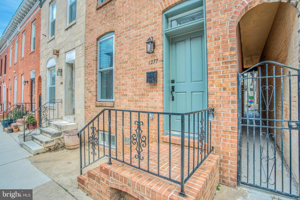 Beautiful renovation in the heart of Federal Hill.  Three bedrooms and three and a half bathrooms all above grade.  Finished basement.  Numerous windows fill the space with natural light.  Third floor is a full master suite with wet bar and bathroom with double vanity and rain shower.  2nd floor has another large master suite with walk-in closet.  Two zone high efficiency HVAC system.   Large parking pad with very easy access.  Large roof deck with sweeping, spectacular views of downtown and the stadiums.  All high quality Kholer fixtures.  All new high quality and highly efficient windows.  The range hood vents properly outside.   Easily walkable to Riverside Park, Federal Hill Park and all of the shops and restaurants Federal Hill has to offer.  15 feet wide lot allows for a spacious interior with wide stairs and hallways.