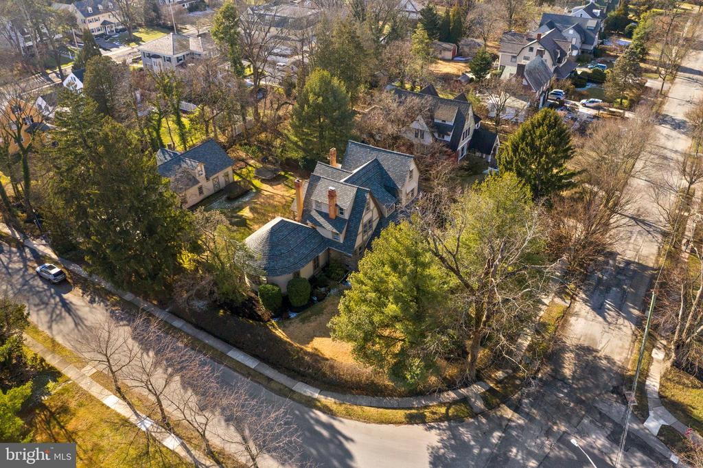 Fabulous Walk-to-Wayne location! This beautiful home is located in popular South Wayne, where you can walk to all of the wonderful restaurants and boutiques that downtown Wayne has to offer.  As you enter the very chic foyer, you will immediately be amazed by the stunning, professionally decorated rooms decorated by Fuller Interiors. Gorgeous diamond-paned leaded glass windows with deep window sills, intricate millwork, 9 ft. ceilings, and handsome hardwood floors enhance the historical charm of each room. Highlights of the first floor include the Parlor with windows overlooking the covered front porch; the comfortable Living Room with built-in bookshelves and a gas fireplace with a breathtaking hand carved mantle; the expansive Formal Dining Room with oversized windows; and a magnificent Great Room with curved walls, a 30~ vaulted ceiling, tremendous gas fireplace with painted brick surround, custom built-ins and a hand painted floor. The Great Room was an addition built by then-owner Arthur B. Lipkin, who at one time was the youngest member of the Philadelphia Orchestra and first violinist with the ensemble. The Main Line Symphony and Orchestra practiced and performed in this very room! You will notice that the leaded glass windows in the Great Room are adorned with musical symbols. This room is the perfect location for entertaining! Finishing off the first floor is the Butler's Pantry with an abundance of shelving; the Kitchen with white cabinetry and stainless steel appliances including a new dishwasher and sink; a cozy Sitting Room off of the Kitchen; and a Powder Room. The second floor features a large Master Suite with Master Bath, spacious Office/Closet area (which could also be a separate bedroom) and the laundry room. In addition there are two more sizable bedrooms and a hall bath with bathtub. The third floor is home to two more substantial bedrooms, a large full bath with walk-in shower, plenty of closet space, and a small sitting area. In addition to th