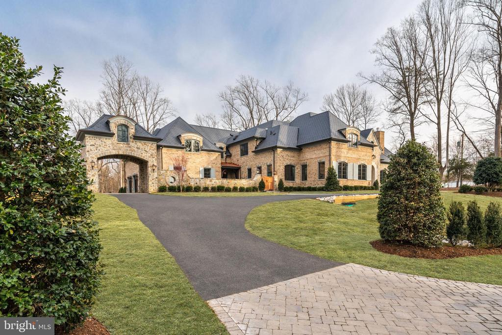 Brand new French Country Estate with Stone and Brick facade on a surprisingly private, wooded lot just minutes to DC! This gorgeous property where classic elegance meets modern luxury and attention to detail is evident in every inch. Fully Finished inside and out with Main Level Master, open floor plan, 6 Bedrooms, 7 Full Baths, 2 Half Baths, circular driveway with a Porte Cochere, motor court & 4-Car Garage. Fantastic outdoor living space with Pool, gardens, lawn space, Pergola and Terraces. This magnificent collaboration of Harrison Design, Artisan Homes and Charles Owen of Fine Landscapes .
